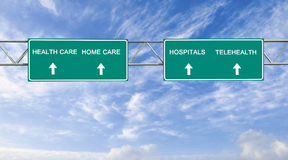 Health care. Road sign to health care Stock Photo