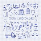 Health care set on the notebook sheet. With thermome ter stethoscope tablet capsule apple ambulance syringe tooth medical card Hospital Medical plaster phone Royalty Free Stock Image