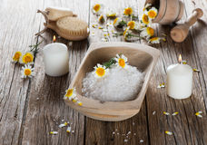 Health care spa objects and chamomiles. Spa setting with  with natural components chamomile on a old wooden background Stock Images