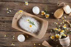 Health care spa objects and chamomiles, top view. Top view of spa setting with with natural components chamomile on a old wooden background Stock Images