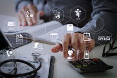 Healthcare costs and fees concept.Hand of smart doctor used a ca. Health care system diagram with health check and symptom on VR dashboard.Hand of smart doctor stock image