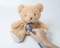 Health care teddy bear heart stethoscope on white background stock photography