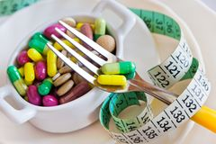 Health care and wellness - diet pills and loosing weight - vario Royalty Free Stock Photography