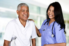 Health Care Worker and Elderly Man Stock Photography