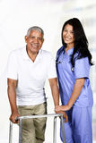 Health Care Worker and Elderly Man. Health care worker helping an elderly man Royalty Free Stock Photo