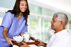 Health Care Worker and Elderly Man Royalty Free Stock Images