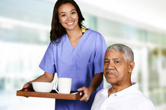 Health Care Worker and Elderly Man Stock Photo