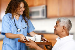 Health Care Worker and Elderly Man. Health care worker helping an elderly man Royalty Free Stock Images