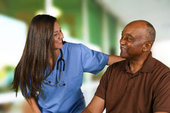 Health Care Worker and Elderly Patient. Health care worker helping an elderly patient Royalty Free Stock Photography