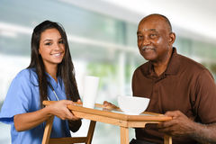 Health Care Worker and Elderly Patient stock photography