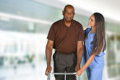 Health Care Worker and Elderly Patient. Health care worker helping an elderly patient Stock Photos