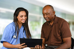 Health Care Worker and Elderly Patient. Health care worker helping an elderly patient Royalty Free Stock Photo