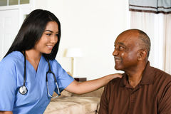 Health Care Worker and Elderly Patient. Health care worker helping an elderly patient Stock Photo