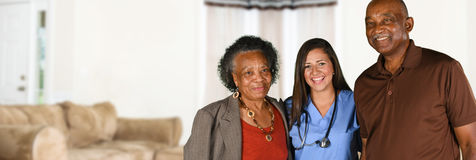 Health Care Worker and Elderly Patient. Health care worker helping an elderly patient Stock Photography