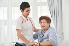 Health care worker helping an elderly patient. Health care worker helping an elderly patient Royalty Free Stock Photo