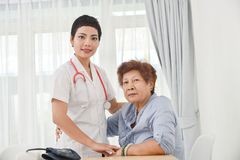Health care worker helping an elderly patient. Stock Photo
