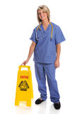 Health Care Worker With Safety Sign Royalty Free Stock Photo