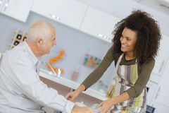 Health care worker serving meal to elderly patient Stock Photo