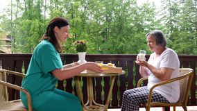Health care worker serving a meal to an elderly patient stock footage
