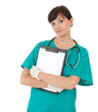 Health care worker woman keeping blank clipboard Stock Photo