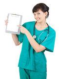 Health care worker woman pointing to blank sign Stock Photography