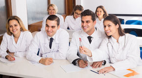 Health-care workers during educational program in school. Adult smiling spanish health-care workers during educational program in medical school Royalty Free Stock Photos