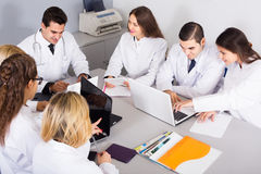 Health-care workers and head physician at colloquium in clinic Stock Photos