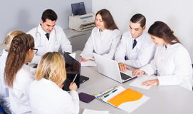 Health-care workers and head physician at colloquium in clinic Stock Image