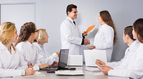 Health-care workers and head physician at colloquium in clinic Royalty Free Stock Photo