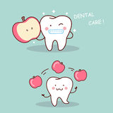Health cartoon tooth with apple Royalty Free Stock Photos