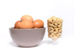 Health cashew nuts, eggs. These are food for energy Royalty Free Stock Photography