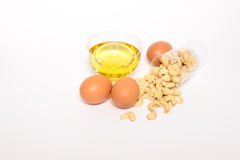 Health cashew nuts, olive oil, eggs Royalty Free Stock Photos