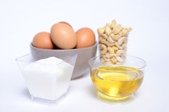 Health cashew nuts, olive oil, eggs and sugar. These are food for energy Royalty Free Stock Photography
