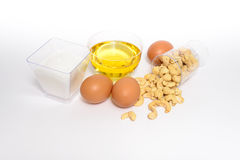 Health cashew nuts, olive oil, eggs and sugar. These are food for energy Stock Photo