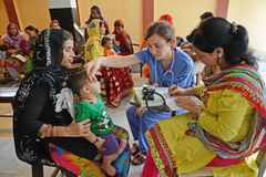 Health Center. Doctors examine the child health at the clinic center, Half of India's children under the age of five are malnourished Royalty Free Stock Image