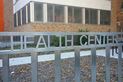 Health Center. A fence with a Health Center sign Royalty Free Stock Photos