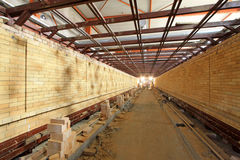 Health ceramics tunnel kiln building internal structure. In a factory Stock Photos