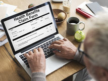Health Check Form Claim History Record Concept. Senior man using computer health check form claim history record Royalty Free Stock Photography