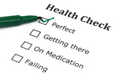 Health checklist. With a green pen Royalty Free Stock Image