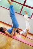 Health club. Women doing stretching and aerobics Stock Image