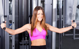 Health club: Girl in a gym Royalty Free Stock Photos