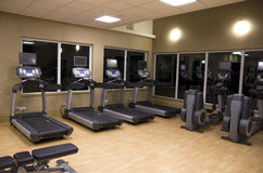 Health club hotel gym room Stock Photography