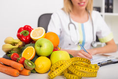 Health coach office with vegetables and tape measure. Writing stock images
