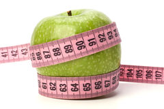 Health concept. Apple and tape measure stock photography