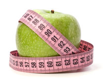 Health concept. Apple with tape measure royalty free stock photography