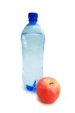 Health concept. Water bottle and red apple Stock Image