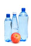 Health concept. With bottles and apple on white Royalty Free Stock Photo