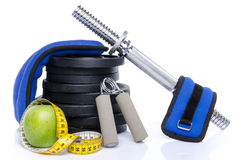 Health concept, an apple with a tape measure and fitness equipme Stock Photo