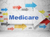 Health concept: arrow with Medicare on grunge wall background Stock Image