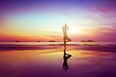 Health concept. Beautifull silhouette of woman practicing yoga, health concept Royalty Free Stock Photos
